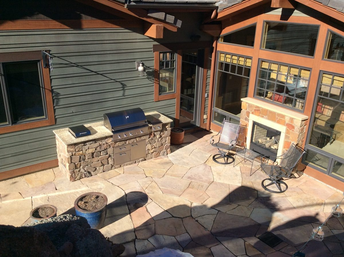 outdoor kitchen fireplace project in the foothills of boulder