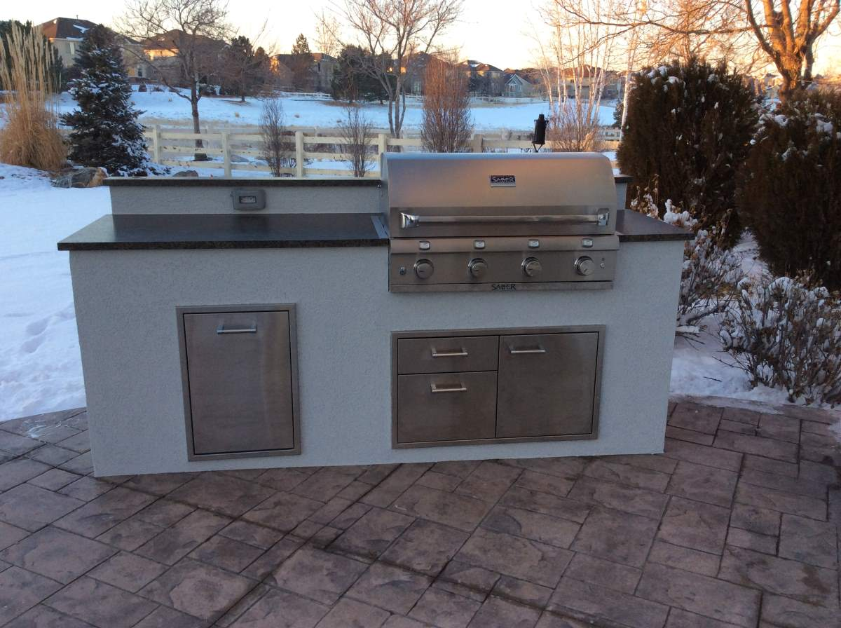 Custom outdoor kitchen matches the house hi tech appliance for Homes with outdoor kitchens