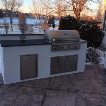 Custom outdoor kitchen matches the house – Hi-Tech Appliance
