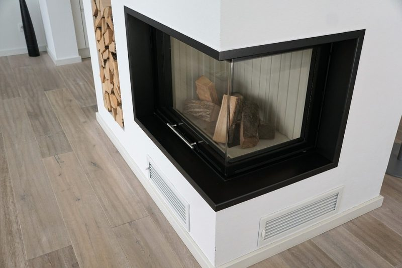 wood burning fireplace with glass doors